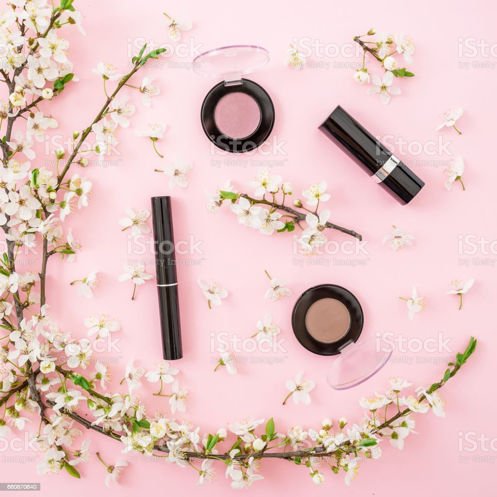 Beauty background spring white flowers and woman cosmetic lipstick beauty background spring white flowers and woman cosmetic lipstick shadows and mascara on izmirmasajfo