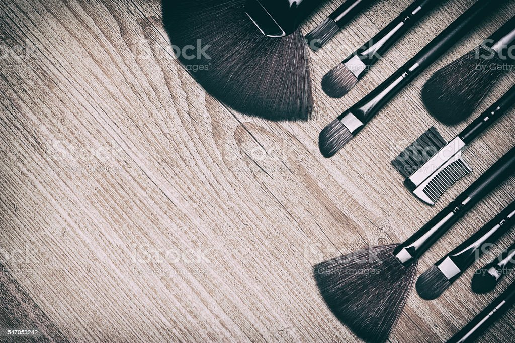 Beauty background with various makeup brushes stock photo