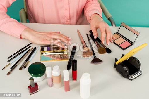 Beauty blogger producing makeup tutorial online translation - image