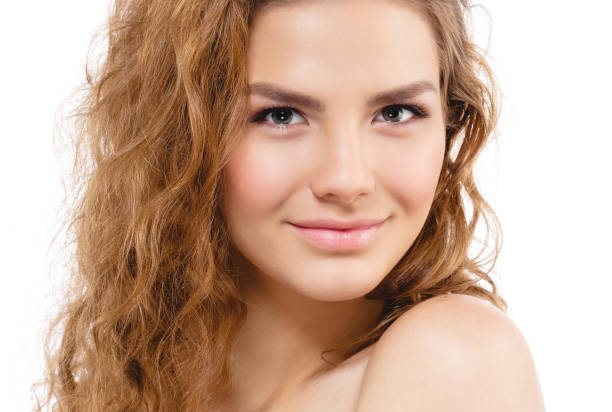 Beauty blond woman with Curly hair and perfect skin portrait. ストックフォト