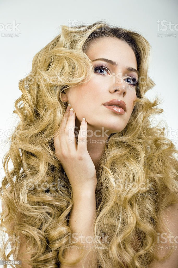beauty blond woman with long curly hair close up isolated stock photo