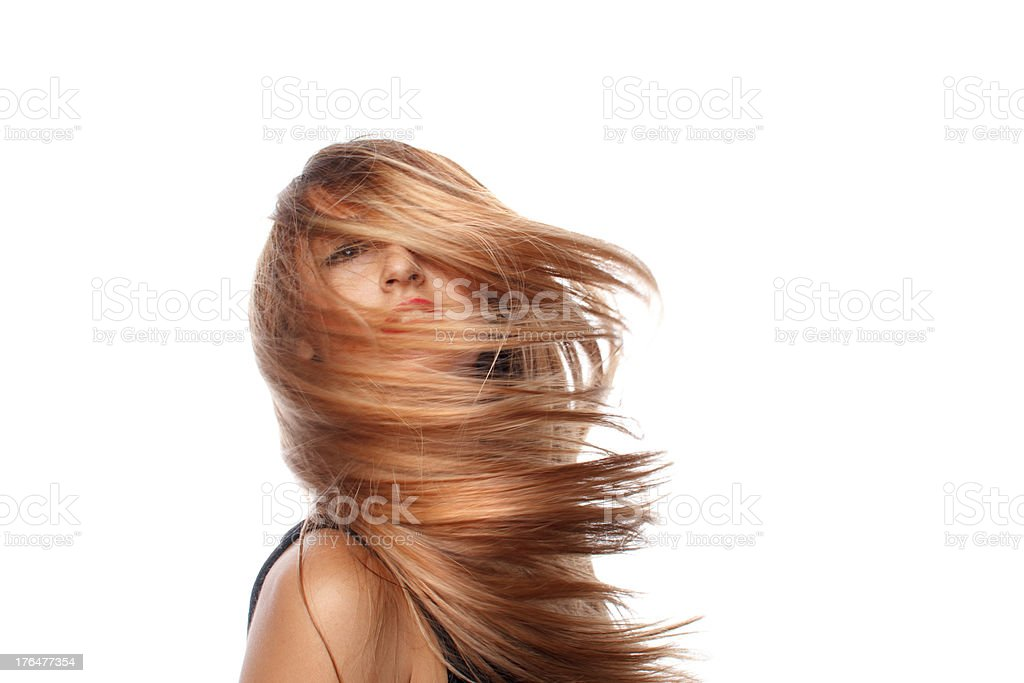 Beauty blonde girl hair tossing stock photo