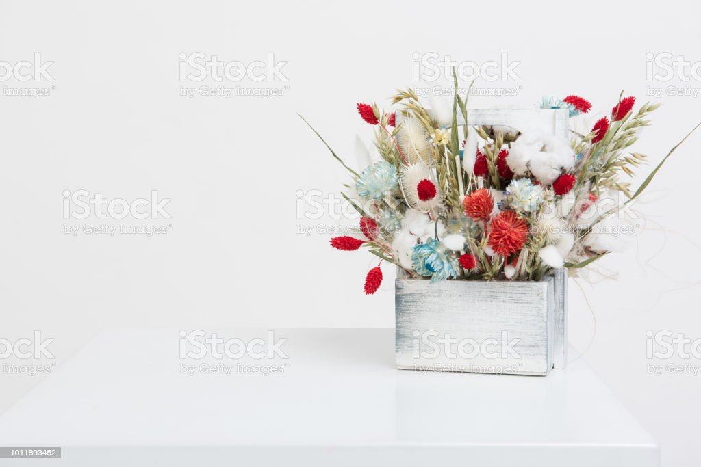 Beauty bouquet of dried flowers on a white