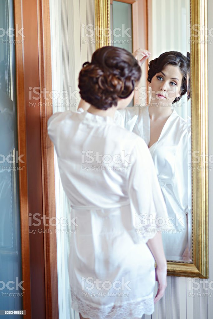 Beauty Bride In Dressing Gown With Bridal Makeup Indoors Stock Photo