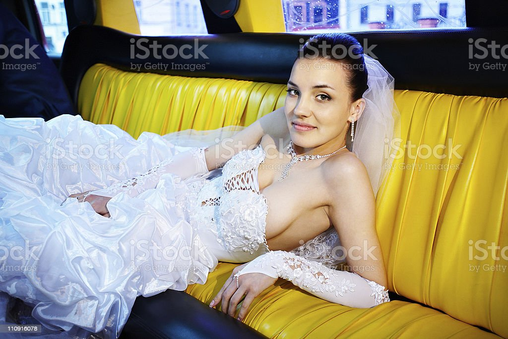 Beauty bride in wedding limousine stock photo