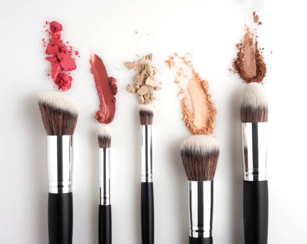 Beauty brushes. Creative concept beauty fashion photo of cosmetic product make up brushes kit with smashed lipstick eyeshadow on white background. make up brush stock pictures, royalty-free photos & images
