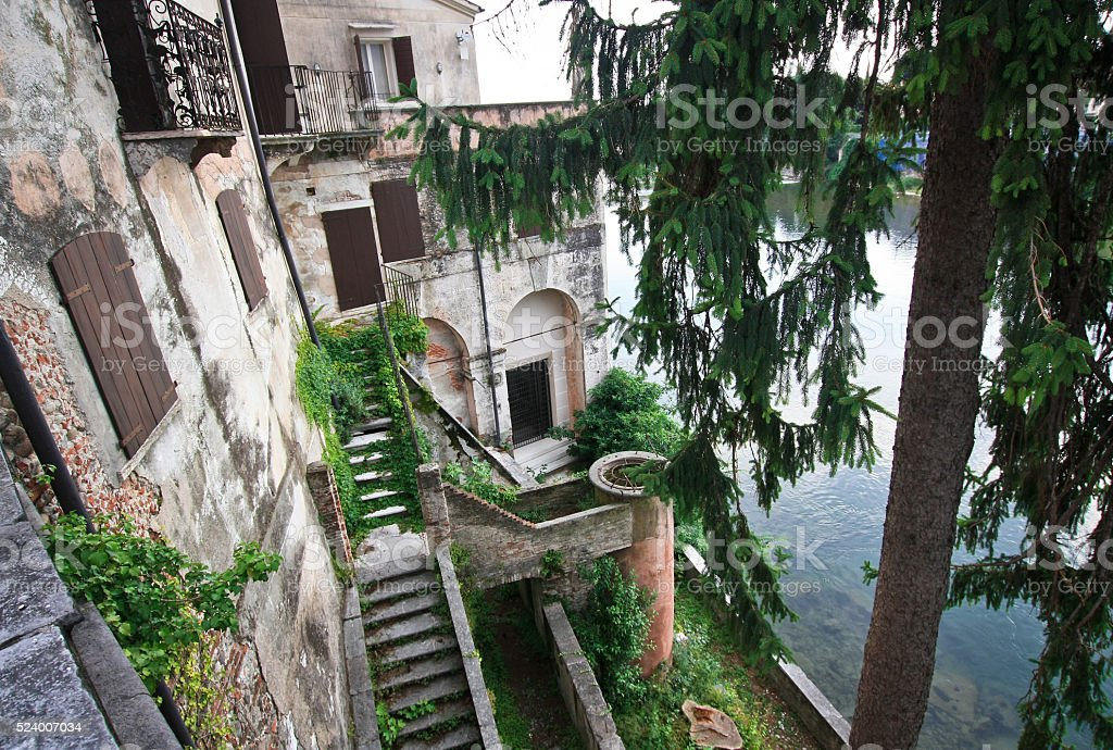 Beauty building on the bluff above the river in Italy stock photo
