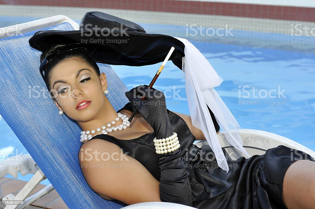 Beauty by the pool stock photo