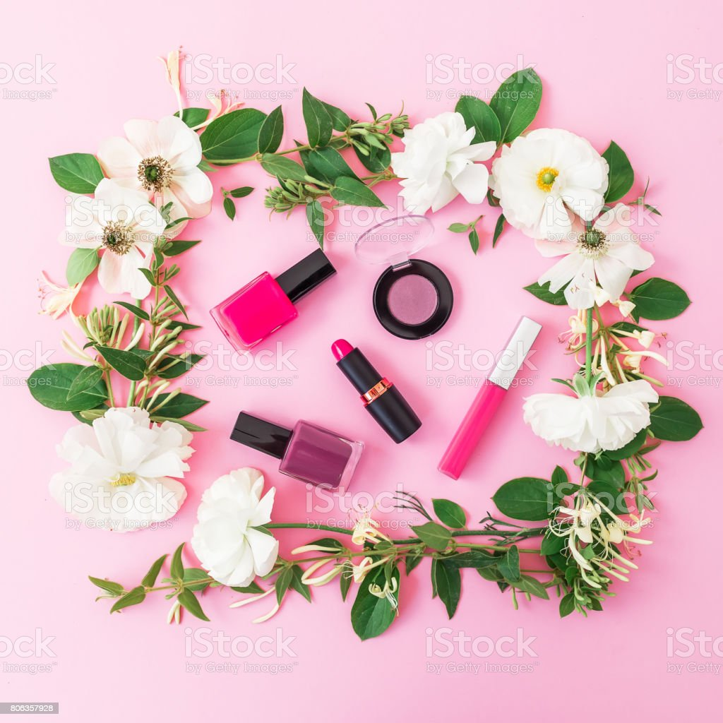 Beauty composition with cosmetics lipstick eye shadows nail polish beauty composition with cosmetics lipstick eye shadows nail polish and floral frame on izmirmasajfo