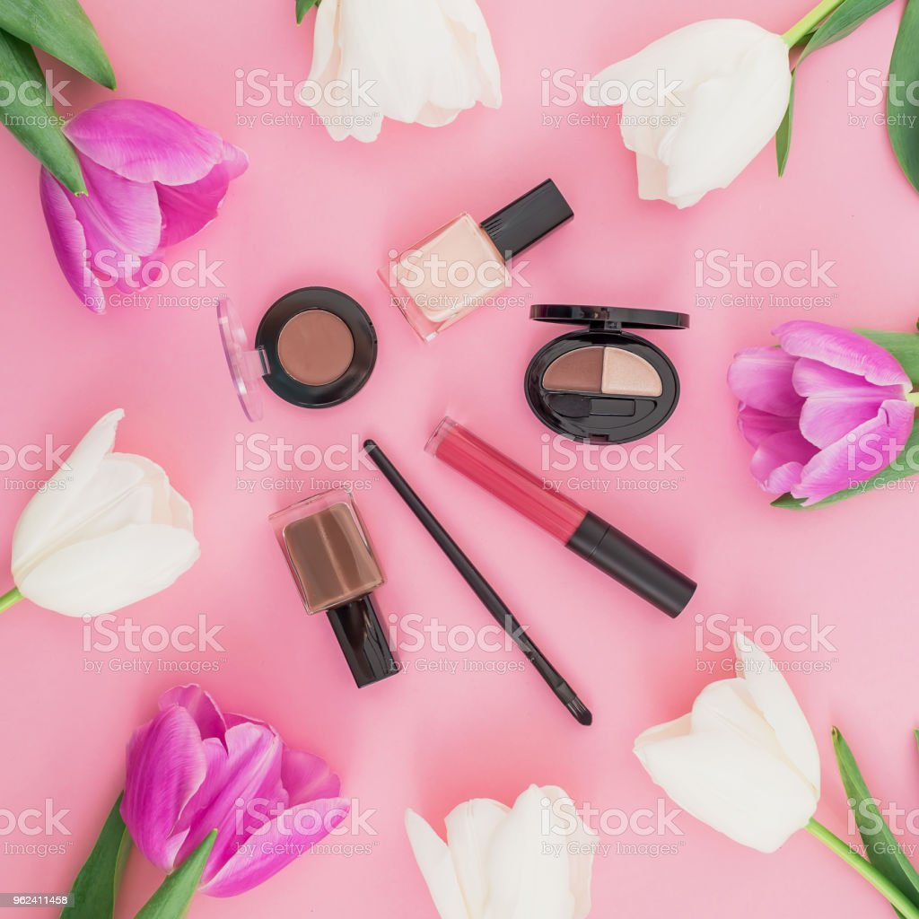Beauty composition with tulips flowers and cosmetics lipstick nail beauty composition with tulips flowers and cosmetics lipstick nail polish on pink background izmirmasajfo