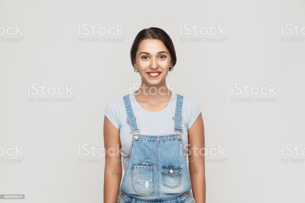 Beauty concept. The attractive brown haired young adult latin woman with perfect clean skin looking and smiling at camera. stock photo