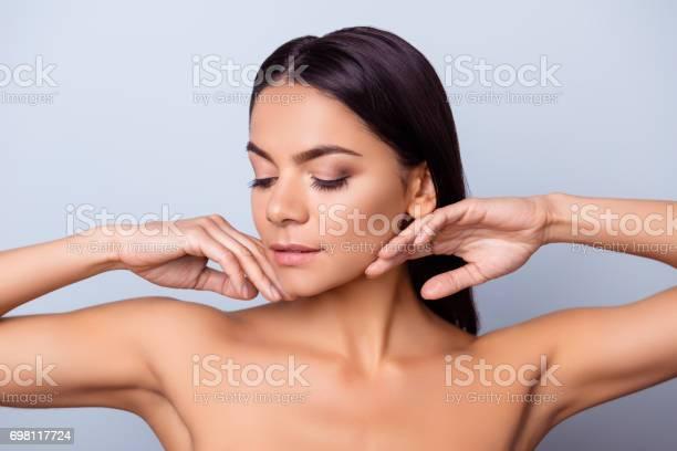 Beauty concept young pretty hispanic lady is touching gently her picture id698117724?b=1&k=6&m=698117724&s=612x612&h=jwtu3qftwmp 9tvxk7eloqdnpmrijqg2nrjmk2wz3i4=