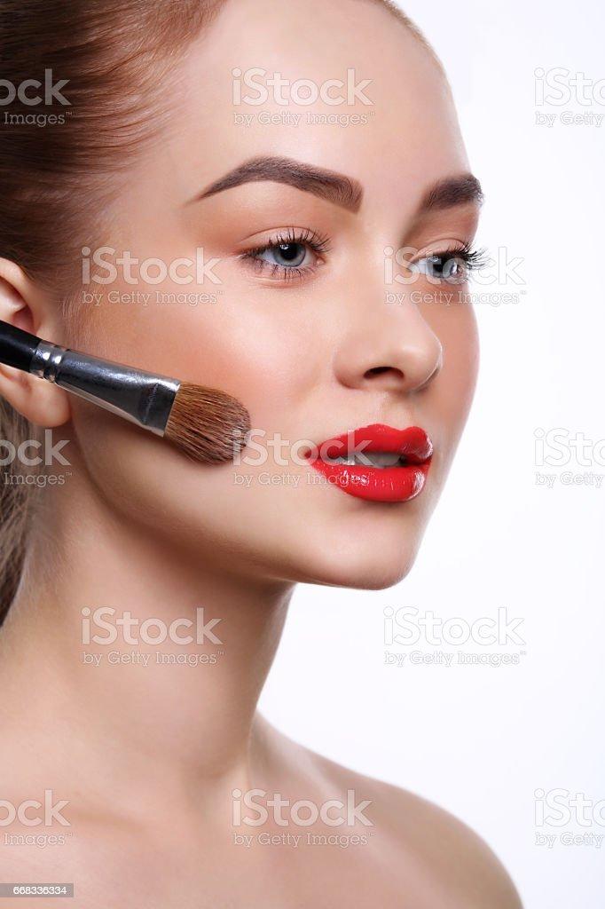 Beauty, cosmetics, finish make-up, powder brush stock photo