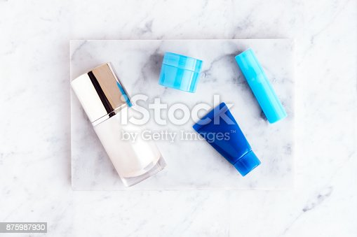 istock Beauty cosmetics on white marble table 875987930