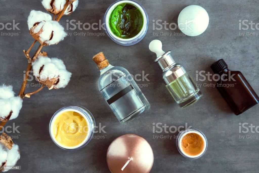 SPA beauty creams and oils on dark table stock photo