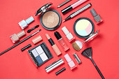 istock Beauty, decorative cosmetics. Makeup brushes set and color eyeshadow palette on pink and blue background , flat lay, top view, Minimalistic style. red background 930934354
