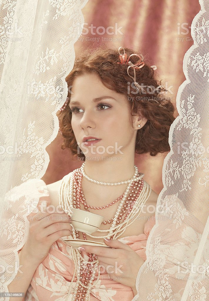 beauty drinking coffee by the window royalty-free stock photo