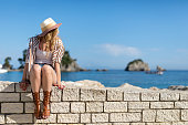 istock Beauty enjoys near sea on summer vacation 1155448051
