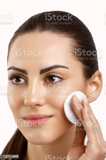 Beauty Face Beautiful Woman With Natural Makeupskin Care Woman Removing Face Makeup With Cotton Pad Close Up Portrait Of Beautiful Healthy Girl With Nude Makeup Touching Perfect Soft Skin Cleaning Fresh Face