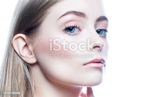 Glamour girl close-up face. Isolated. Blonde hair, blue eyes