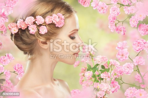 istock Beauty face of young beautiful woman with pink flowers 509395449