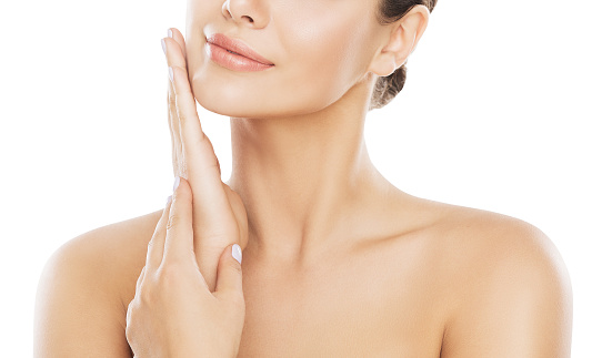 istock Beauty Face Skin Care, Woman Moisturizing and Massaging Cheek By Hand, White Isolated 1090563778