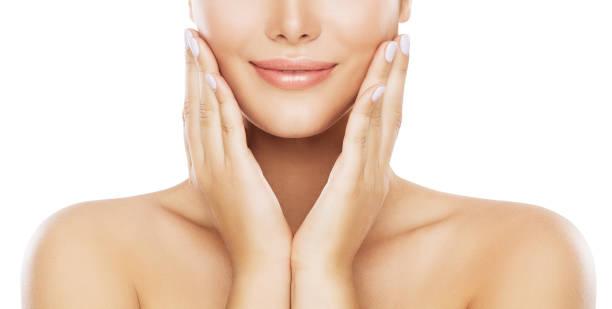 Beauty Face Skin Care, Woman Moisturizing Cheek By Hands stock photo