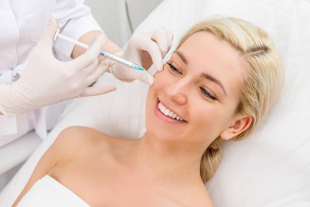 beauty facial injections - nadeldesigns stock-fotos und bilder