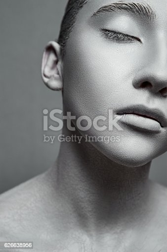 istock Beauty Fashion female Model with Sculpture Makeup 626638956