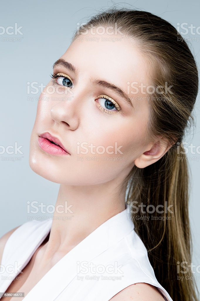 Beautiful Face of Young Woman with Clean Fresh Skin close up isolated...