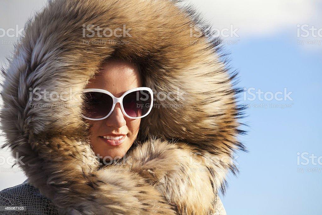Beauty Fashion Model Girl in Fur Coat. stock photo