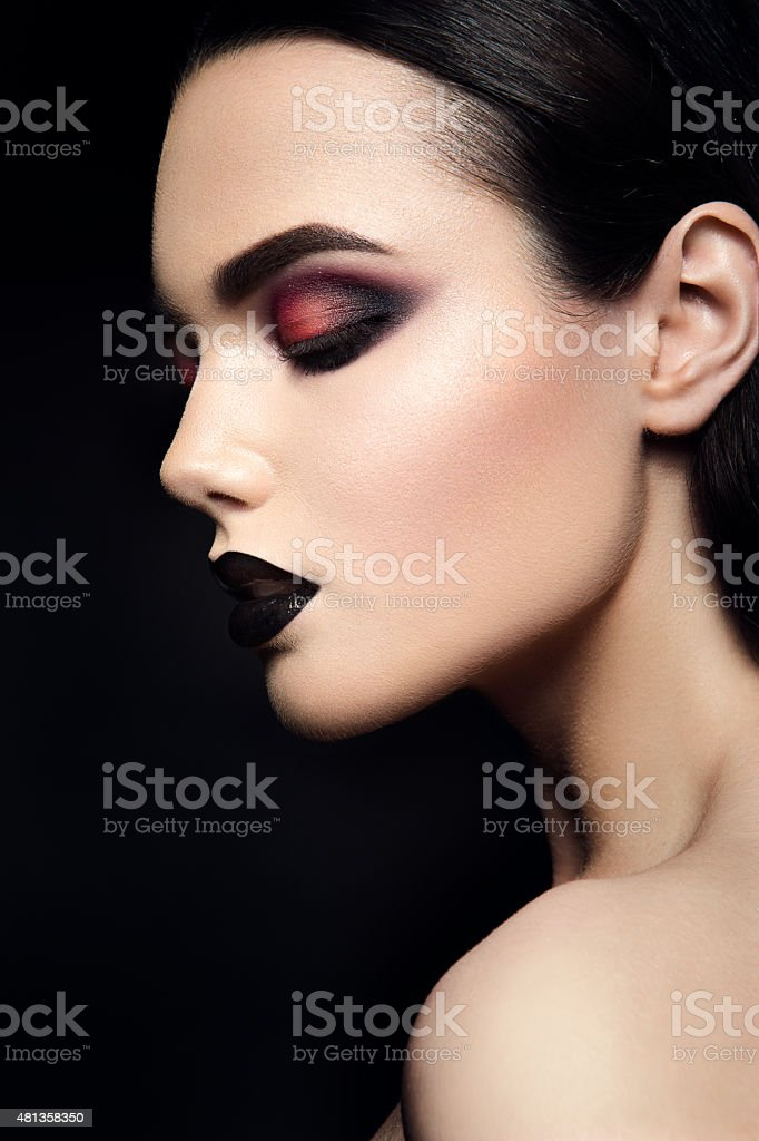 Beauty Fashion Model Girl with Black Make up. Dark Lipstick stock photo