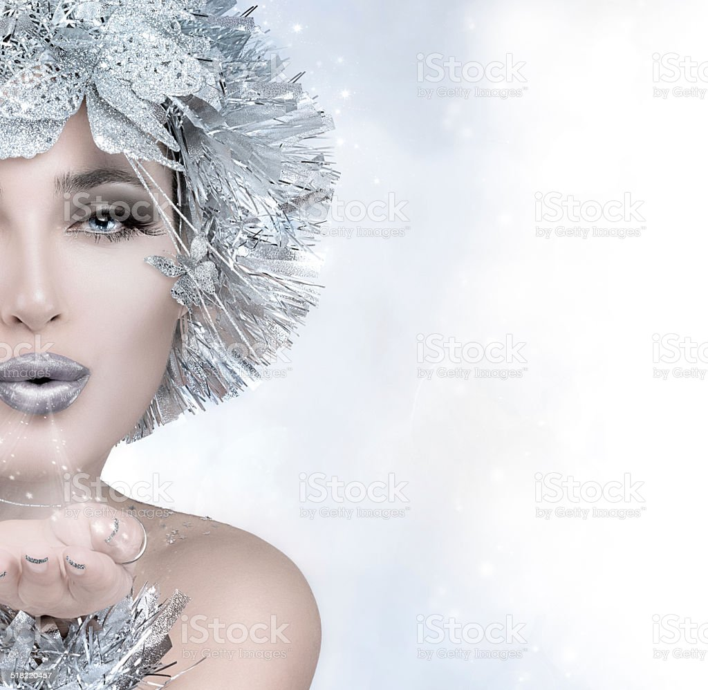 Beauty Fashion Winter. Christmas Girl Sending a Kiss stock photo