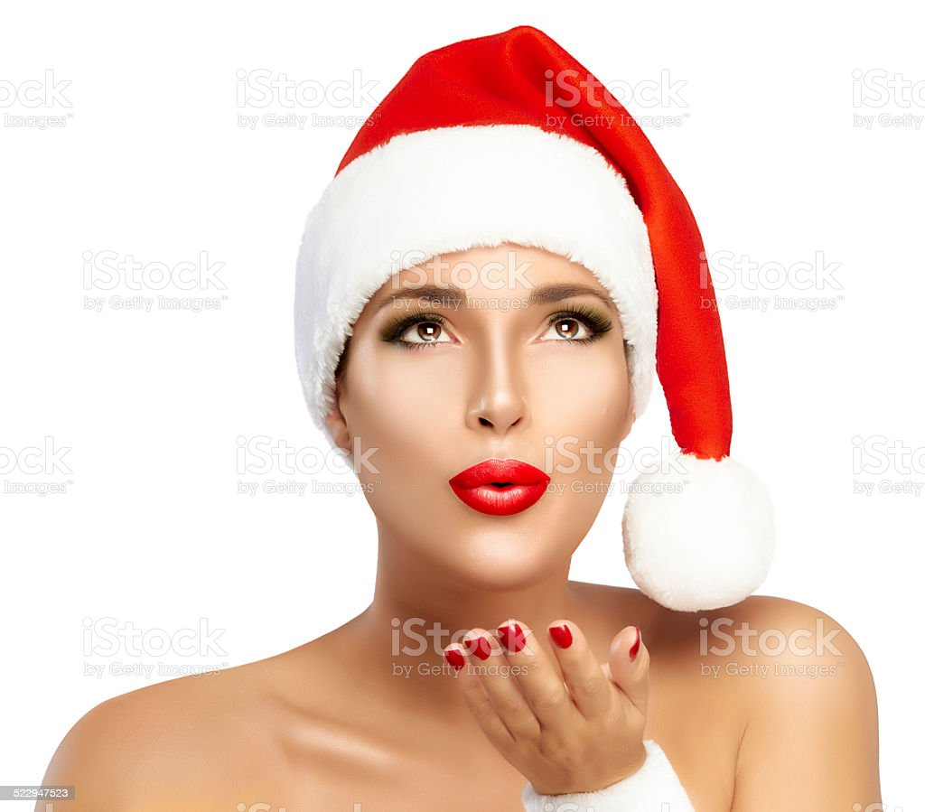 Beauty Fashion. Young Woman with Santa Hat Sending a Kiss stock photo