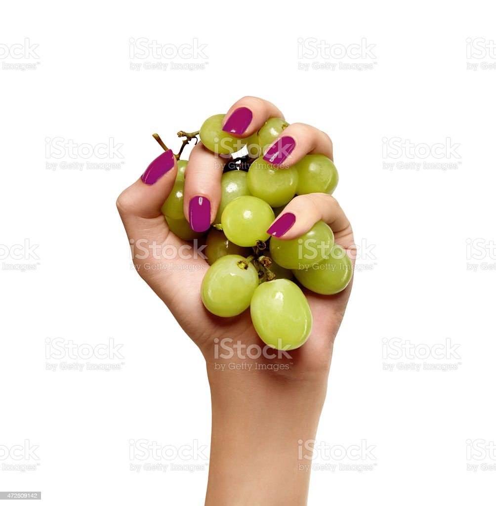 beauty female hand with green grapes on a white background stock photo