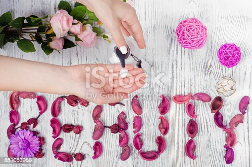 1151624350istockphoto Beauty female hands cream for hands flowers 851053986