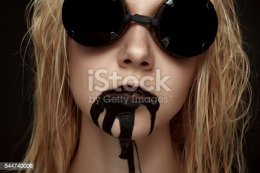 istock Beauty female Model with Oil from her Mouth 544740006