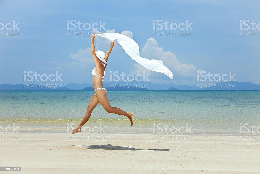 beauty girl jumping on sea background stock photo