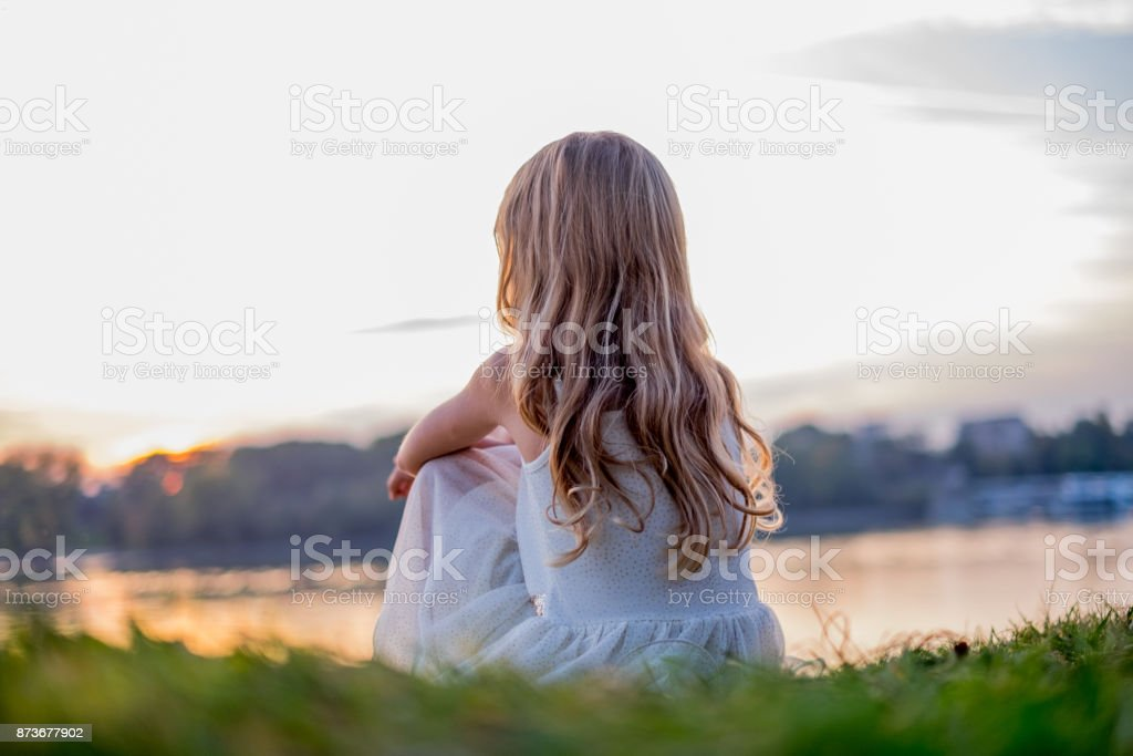 Beauty girl looking sunset Back view blond hair girl looking sunset Adventure Stock Photo