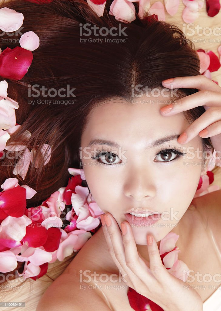 beauty Girl smiling close-up with rose background royalty-free stock photo