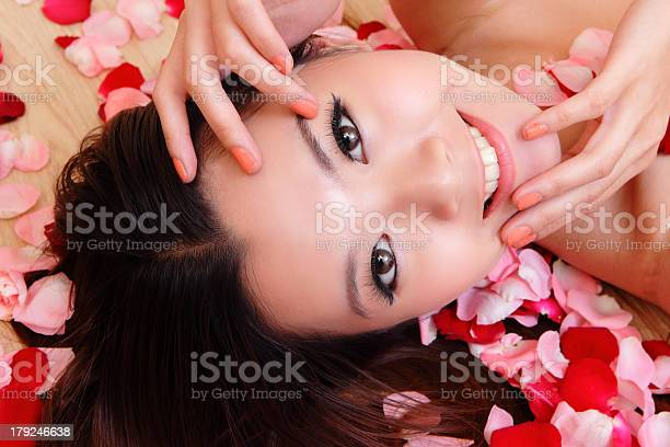 Beauty girl smiling closeup with rose picture id179246638?b=1&k=6&m=179246638&s=612x612&h=jrsjizsk6dg zy5pwj0xmc t8zifphaokd7azcowdve=