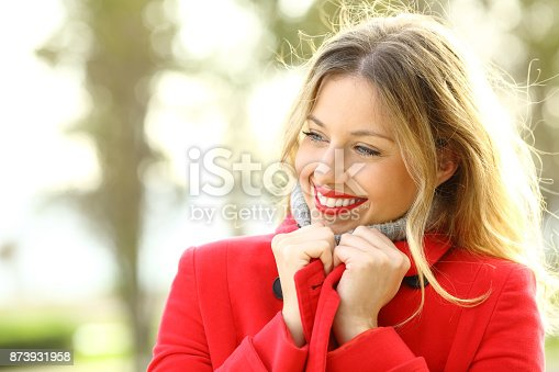 1051172208 istock photo Beauty girl warmly clothed wearing red jacket in winter 873931958