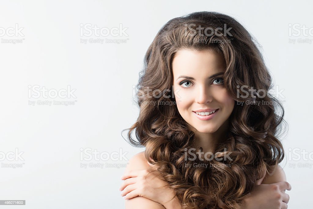 Beauty Girl With Healthy Long Curly Hair. stock photo