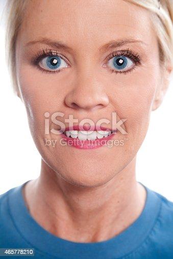 673361134 istock photo Beauty, Health. Beautiful blond woman. Head, shoulders. Blue shirt. 465778210