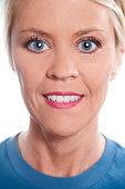 istock Beauty, Health. Beautiful blond woman. Head, shoulders. Blue shirt. 465778210