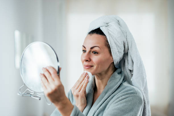 Beauty, hygiene and people concept. A picture of a woman cleaning her face. stock photo