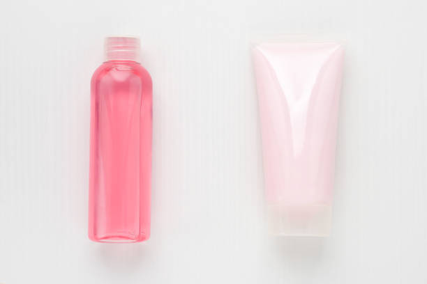 Beauty, hygiene, cosmetics, skin care. A set for washing. Foam cleansing, moisturizing, nourishing from acne and wrinkles and pink tonic on a white background stock photo