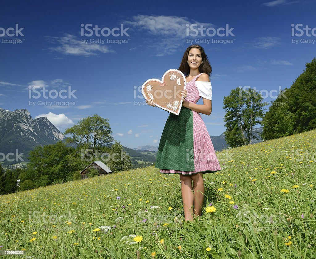 Beauty in Dirndl with Lebkuchen Gingerbread Heart stock photo
