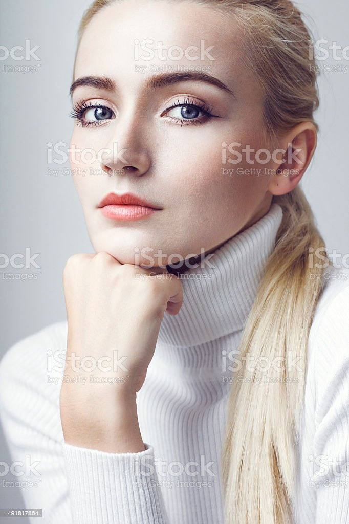 Beauty in white pullower stock photo