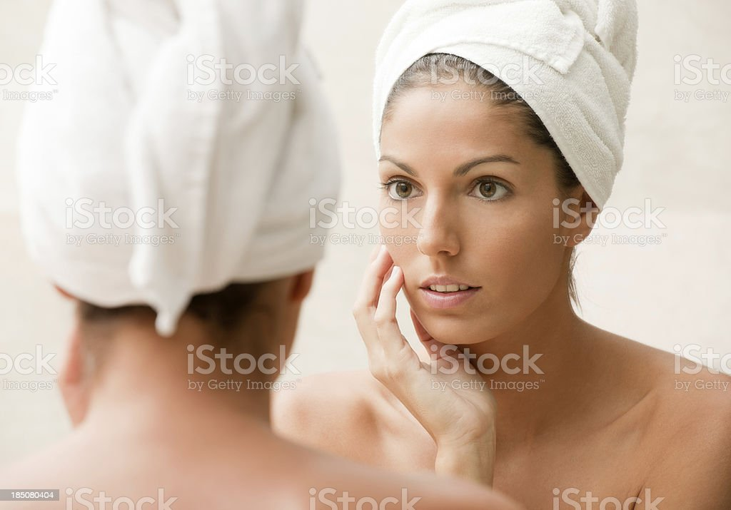 Beauty looking at herself in the Mirror (XXXL) royalty-free stock photo